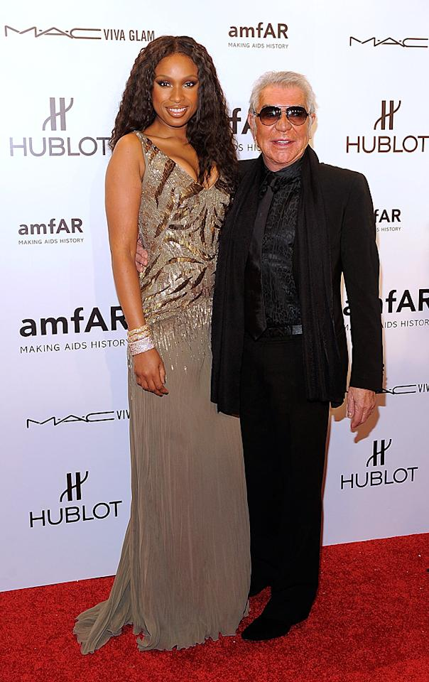 A slim and sexy Jennifer Hudson donned a sequined Roberto Cavalli gown and then mingled with the designer himself. (2/8/2012)