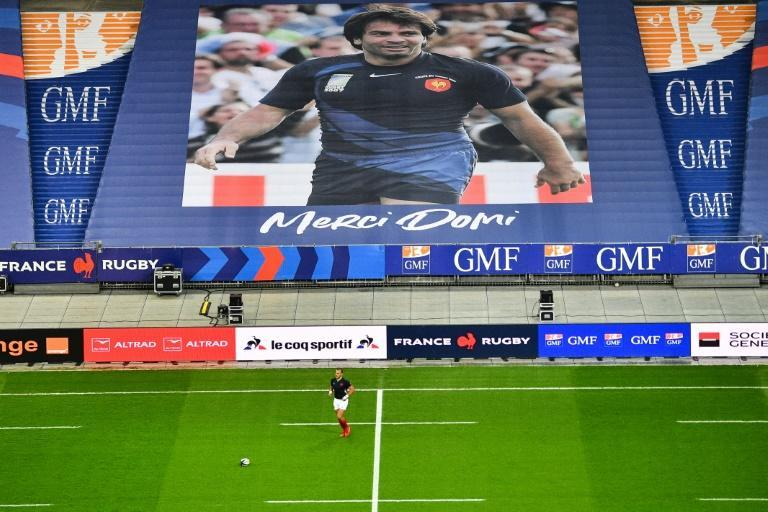 A giant poster commemorated late France winger Christophe Dominici at the Stade de France