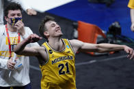 Michigan guard Franz Wagner celebrates after a second-round game against LSU in the NCAA men's college basketball tournament at Lucas Oil Stadium Monday, March 22, 2021, in Indianapolis. Michigan won 86-78. (AP Photo/AJ Mast)