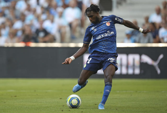 Reims' Boulaye Dia scores the opening goal during the French League One soccer match between Marseille and Reims at the Velodrome Stadium in Marseille, France, Saturday, Aug. 10, 2019. (AP Photo/Daniel Cole)