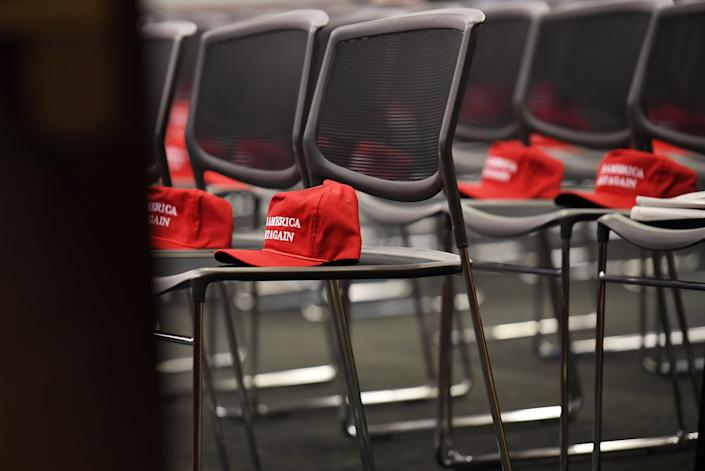 Make America Great Again hats sit on chairs before the start of a morning Republican event at the Capitol on Nov. 15, 2016.
