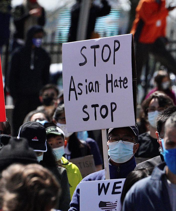 Hundreds of people gather in Atlanta, Ga. on Saturday, Mar. 20, 2021 to protest the killing of eight people, six of them Asian, in Atlanta area massage businesses shootings on March 16, and the increasing violence toward Asian people in the country.