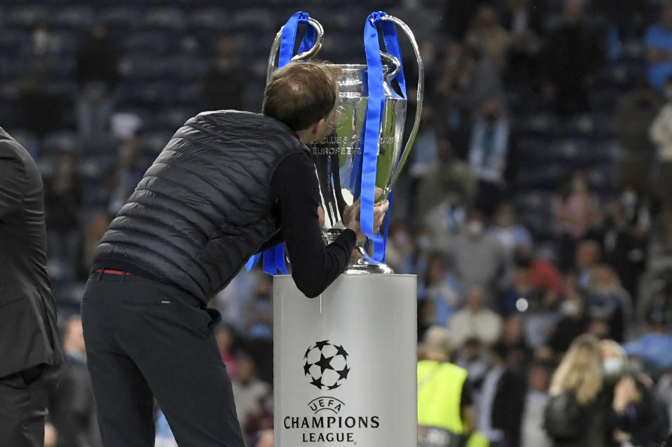 Chelsea's head coach Thomas Tuchel kisses the trophy at the end of the Champions League final soccer match between Manchester City and Chelsea at the Dragao Stadium in Porto, Portugal, Saturday, May 29, 2021. Chelsea won the match 1-0. (Pierre Philippe Marcou/Pool via AP)
