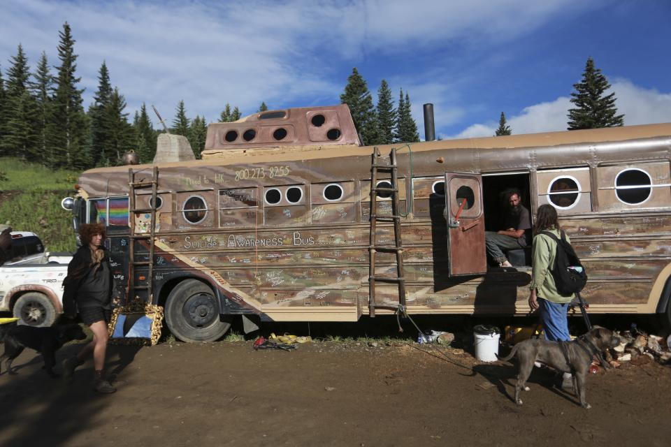 A modified school bus connected to the coffee-producing camp Montana Mud is seen on Friday, July 2, 2021, in the Carson National Forest, outside of Taos, N.M. More than 2,000 people have made the trek into the mountains of northern New Mexico as part of an annual counterculture gathering of the so-called Rainbow Family. While past congregations on national forest lands elsewhere have drawn as many as 20,000 people, this year's festival appears to be more reserved. Members (AP Photo/Cedar Attanasio)
