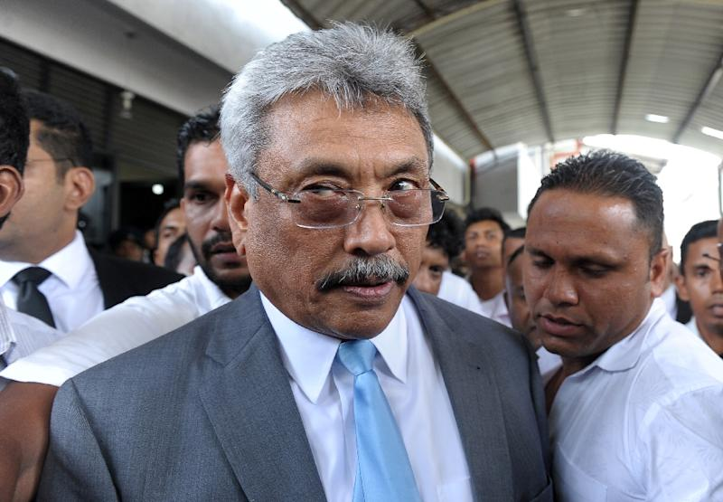 Sri Lanka's former defence secretary Gotabhaya Rajapakse, the brother of ex-president Mahinda Rajapakse, leaves a court in Colombo on September 30, 2016