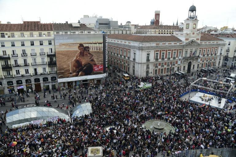 """Demonstrators gather at Puerta del Sol square after a demonstration marking the fifth anniversary of the """"Indignados"""" movement in Madrid, on May 15, 2016"""