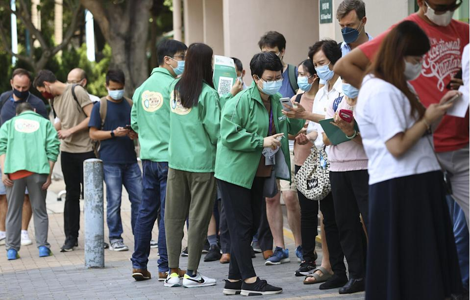 Hongkongers queue up for BioNTech Covid-19 vaccinations at Queen Elizabeth Stadium in Wan Chai. Photo: Dickson Lee