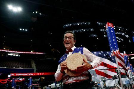 Colbert poses for the camera on the floor of the Republican National Convention in Cleveland