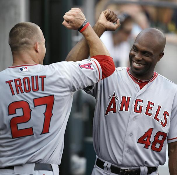 Los Angeles Angels' Mike Trout (27) is congratulated by Torii Hunter (48) after hitting a two-run home run against the Detroit Tigers in the second inning of a baseball game in Detroit, Tuesday, July 17, 2012. (AP Photo/Paul Sancya)