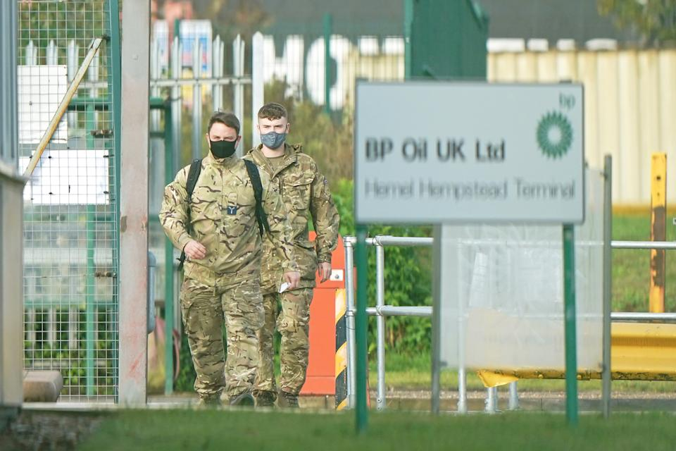 Members of the armed forces at Buncefield oil depot, known as the Hertfordshire Oil Storage Terminal, in Hemel Hempstead. Picture date: Monday October 4, 2021.