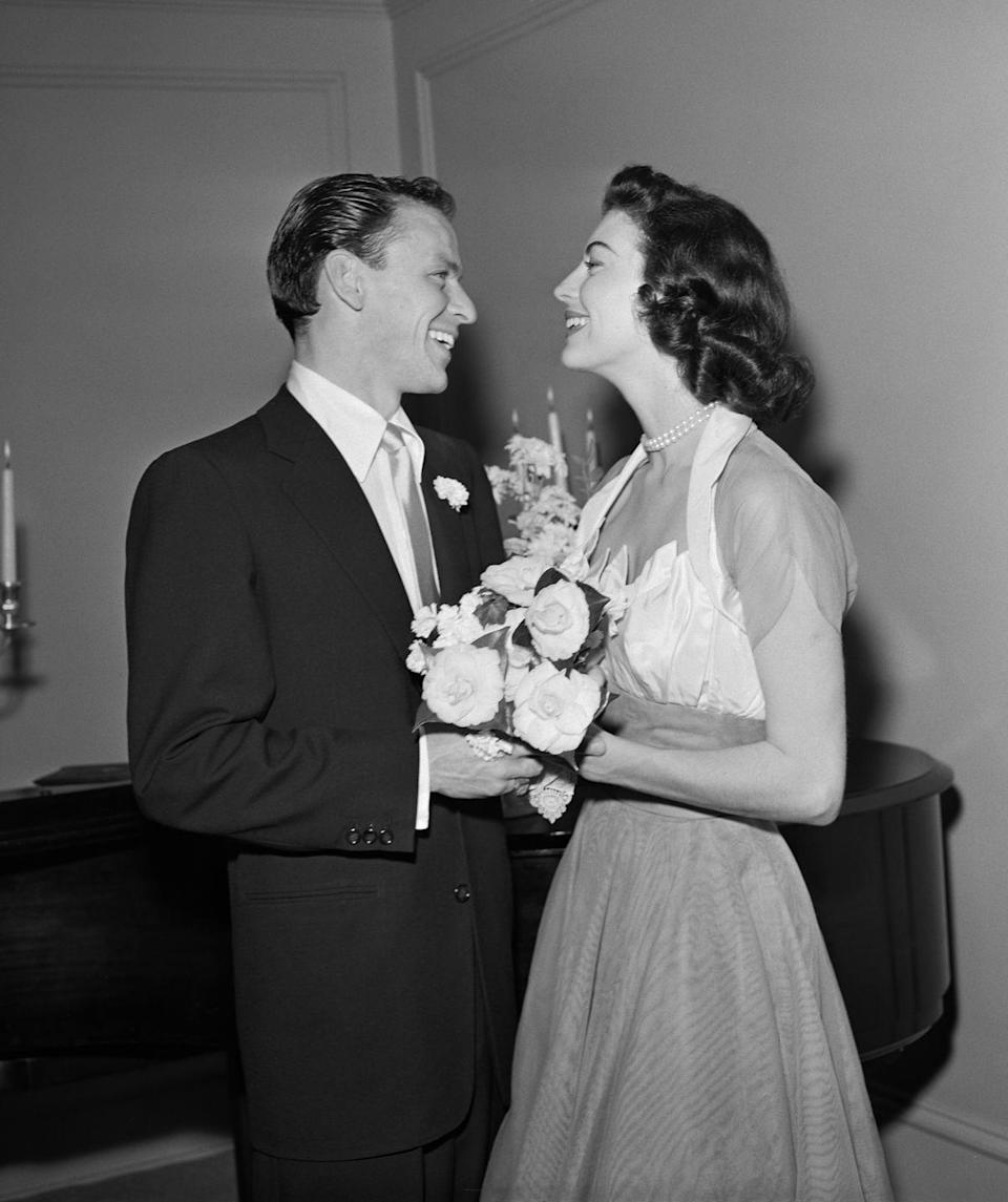 <p>For her 1951 wedding to Frank Sinatra, Ava Gardner wore a moiré silk gown with a fitted bodice, a box pleated neckline, and chiffon cap sleeves. As it was the bride's third marriage, she decided against wearing a veil, instead accessorizing with a double-strand pearl choker. </p>