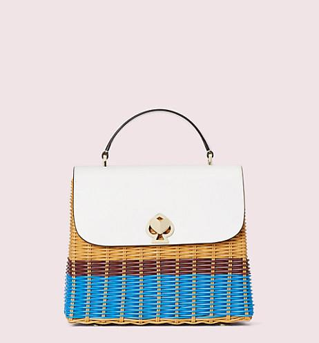 Romy Wicker Medium Top-Handle Bag. Image via Kate Spade.
