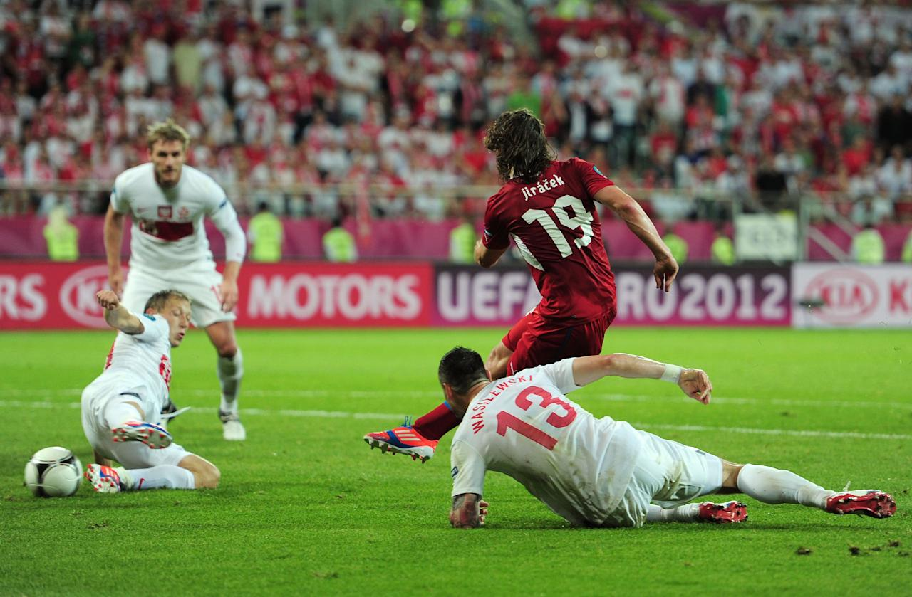 WROCLAW, POLAND - JUNE 16:  Petr Jiracek of Czech Republic scores their first goal past  Marcin Wasilewski and Rafal Murawski of Poland during the UEFA EURO 2012 group A match between Czech Republic and Poland at The Municipal Stadium on June 16, 2012 in Wroclaw, Poland.  (Photo by Jamie McDonald/Getty Images)