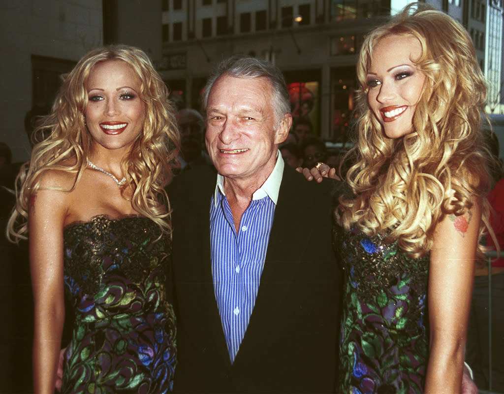 E367623 01: (ITALY OUT) Hugh Hefner, center, celebrates the upcoming May issue of Playboy with his girlfriends, cover girls Sandy and Mandy Bentley, April 12, 2000 in New York City. (Photo by Arnaldo Magnani)