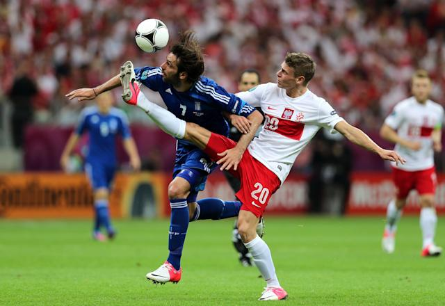 WARSAW, POLAND - JUNE 08: Lukasz Piszczek of Poland and Giorgos Samaras of Greece battle for the ball during the UEFA EURO 2012 group A match between Poland and Greece at National Stadium on June 8, 2012 in Warsaw, Poland. (Photo by Alex Grimm/Getty Images)