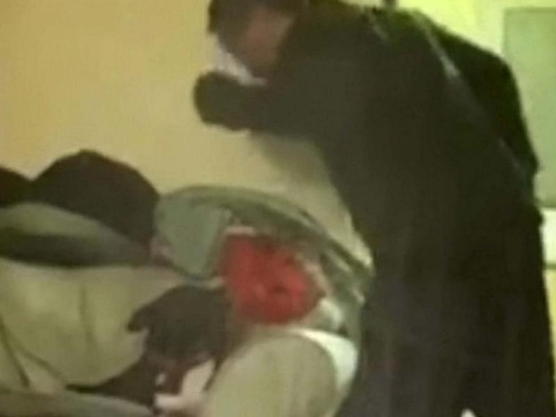 Footage released by the RSPCA showed Kieran Huelin repeatedly hitting the Staffordshire bull terrier: RSPCA /SWNS.COM