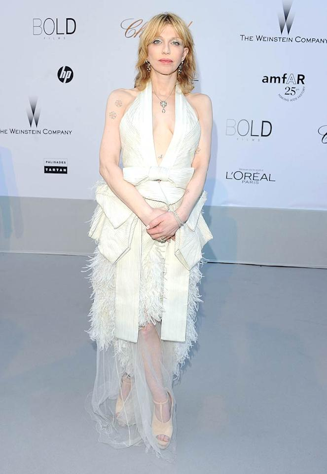 """The plunging, swan-like wedding gown Courtney Love dared to wear to amfAR's annual charity gala in Cannes, France, leaves us speechless ... and not in a good way. Discuss amongst yourselves! Venturelli/<a href=""""http://www.wireimage.com"""" target=""""new"""">WireImage.com</a> - May 19, 2011"""