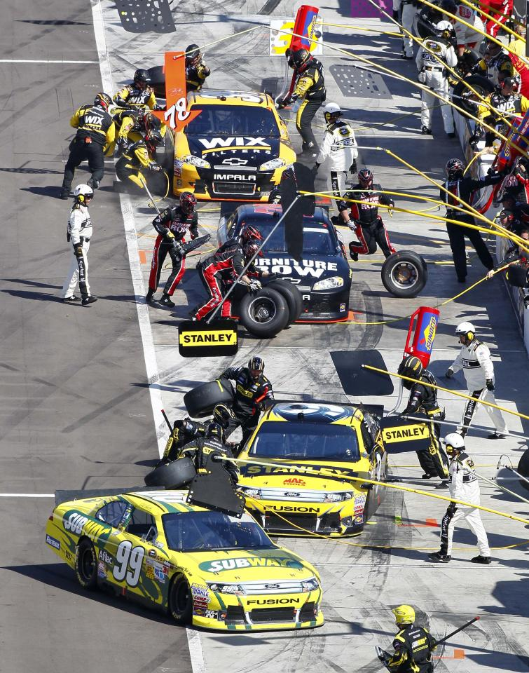Drivers make pit stops during the NASCAR Sprint Cup Series auto race, Sunday, March 4, 2012, at Phoenix International Raceway in Avondale, Ariz. (AP Photo/Matt York)