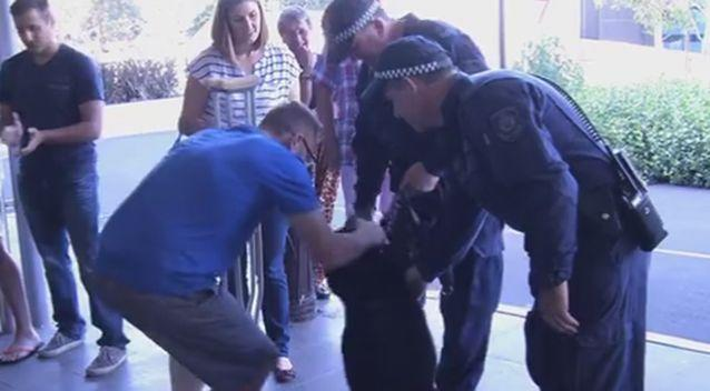 The emotional scene at Senior Constable Luke Warburton walked out of hospital on crutches today. Photo: 7 News