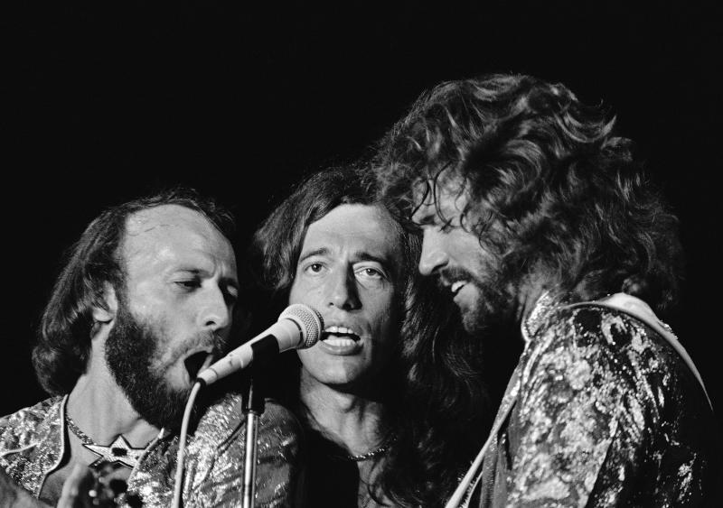 "** FILE ** In this Nov. 6, 1979 file photo, The Bee Gees, from left, Maurice, Robin and Barry Gibb perform in Miami Beach, Fla. Doctors have revived the old disco song ""Stayin' Alive"" and found that it might actually live up to its name. At 103 beats per minute, the Bee Gees' sung-in-falsetto tune has almost the perfect rhythm to help jump-start a stopped heart. (AP Photo/Phil Sandlin, file)"
