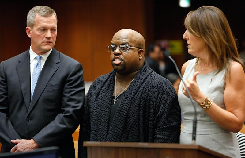 Singer Cee Lo Green, whose real name is Thomas DeCarlo Callaway, center, flanked by attorneys Thomas P. O'Brien, left, and Blair Berk, speaks during his arraignment at the Clara Shortridge Foltz Criminal Justice Center in downtown Los Angeles on Monday, Oct. 21, 2013. Green pleaded not guilty to giving a woman ecstasy at a Los Angeles restaurant during a 2012 dinner, and prosecutors declined to file a rape count against the singer because of insufficient evidence. The singer's bail was set at $30,000 and he is due back in court on Nov. 20, 2013. (AP Photo/Los Angeles Times, Mel Melcon, Pool)