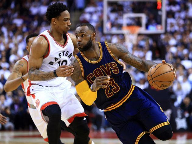 DeMar DeRozan bodies up on LeBron James. (Getty Images)