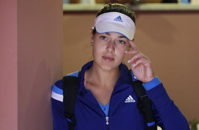 Ana Ivanovic of Serbia looks on before the start of her women's singles match against Maria Sharapova at the Rome Masters tennis tournament May 15, 2014. REUTERS/Max Rossi (ITALY - Tags: SPORT TENNIS)