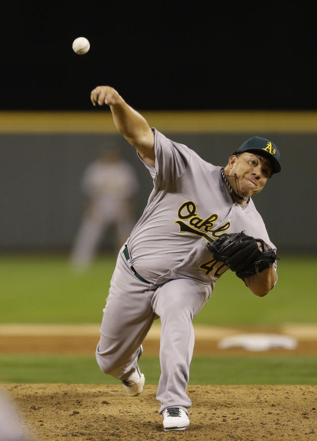 Oakland Athletics starting pitcher Bartolo Colon throws against the Seattle Mariners in the third inning of a baseball game, Friday, Sept. 27, 2013, in Seattle. (AP Photo/Ted S. Warren)