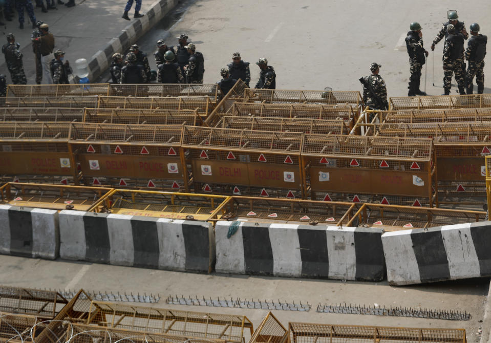 Iron spikes are seen along with cemented barricades at Delhi-Utttar Pradesh border, in New Delhi, India, Tuesday, Feb. 2, 2021. Indian authorities Tuesday heavily ramped up security along three main protest sites outside New Delhi's border, using cemented iron spikes, steel barricades and deployed hundreds of police in riot gear in their latest attempt to thwart the growing farmers' protest on the edges of the capital. (AP Photo/Manish Swarup)