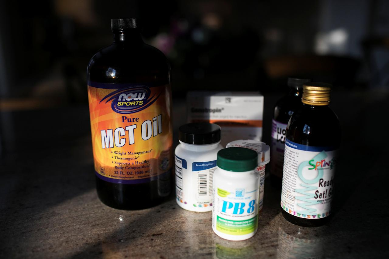 Nobel Lett, who has Prader-Willi Syndrome and is treated under the Children's Health Insurance Program (CHIP) has his supplements organized on the counter in his home in Columbus, Ohio, U.S. January 17, 2018.   REUTERS/Maddie McGarvey