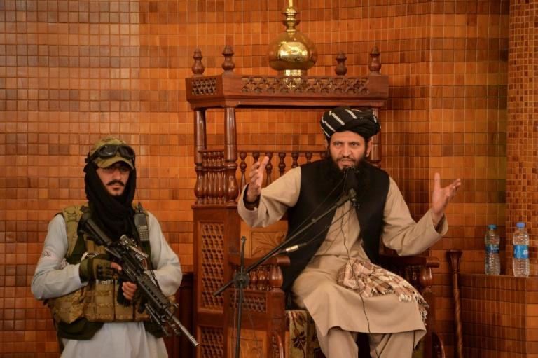 Flanked by gunmen, the scholar rallied the faithful at the Abdul Rahman Mosque with stories of Afghan victories