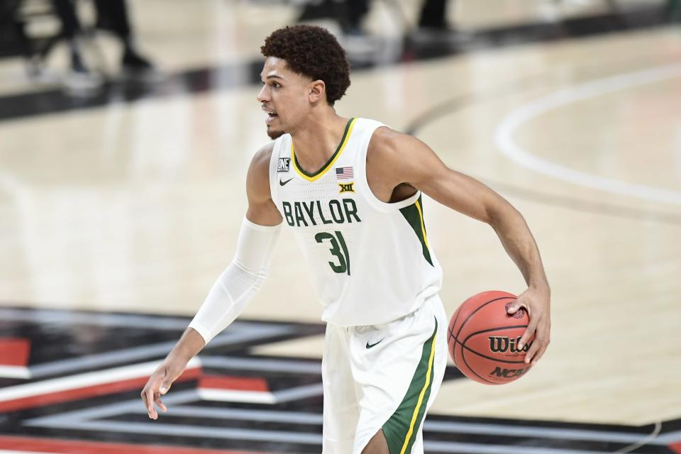 Baylor's MaCio Teague (31) controls the ball during the first half of an NCAA college basketball game against Texas Tech in Lubbock, Texas, Saturday, Jan. 16, 2021. (AP Photo/Justin Rex)