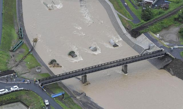 <p>This aerial photo shows a destroyed railway bridge in Hita, Oita prefecture, southwestern Japan Thursday, July 6, 2017. Troops were working Thursday to rescue families left stranded by flooding in southern Japan. Heavy rain warnings were in effect for much of the southern island of Kyushu after Typhoon Nanmadol swept across Japan earlier in the week. (Photo: Nozomu Endo/Kyodo News via AP) </p>