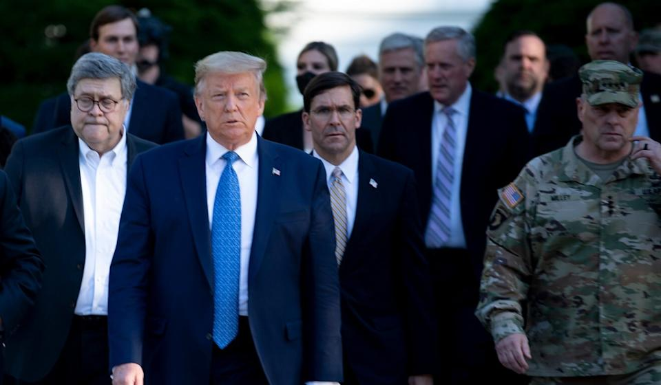 President Donald Trump is flanked by Attorney General William Barr (left) and Secretary of Defence Mark Esper as they walk from the White House after the area was cleared of protesters on June 1. Photo: AFP via Getty Images/TNS