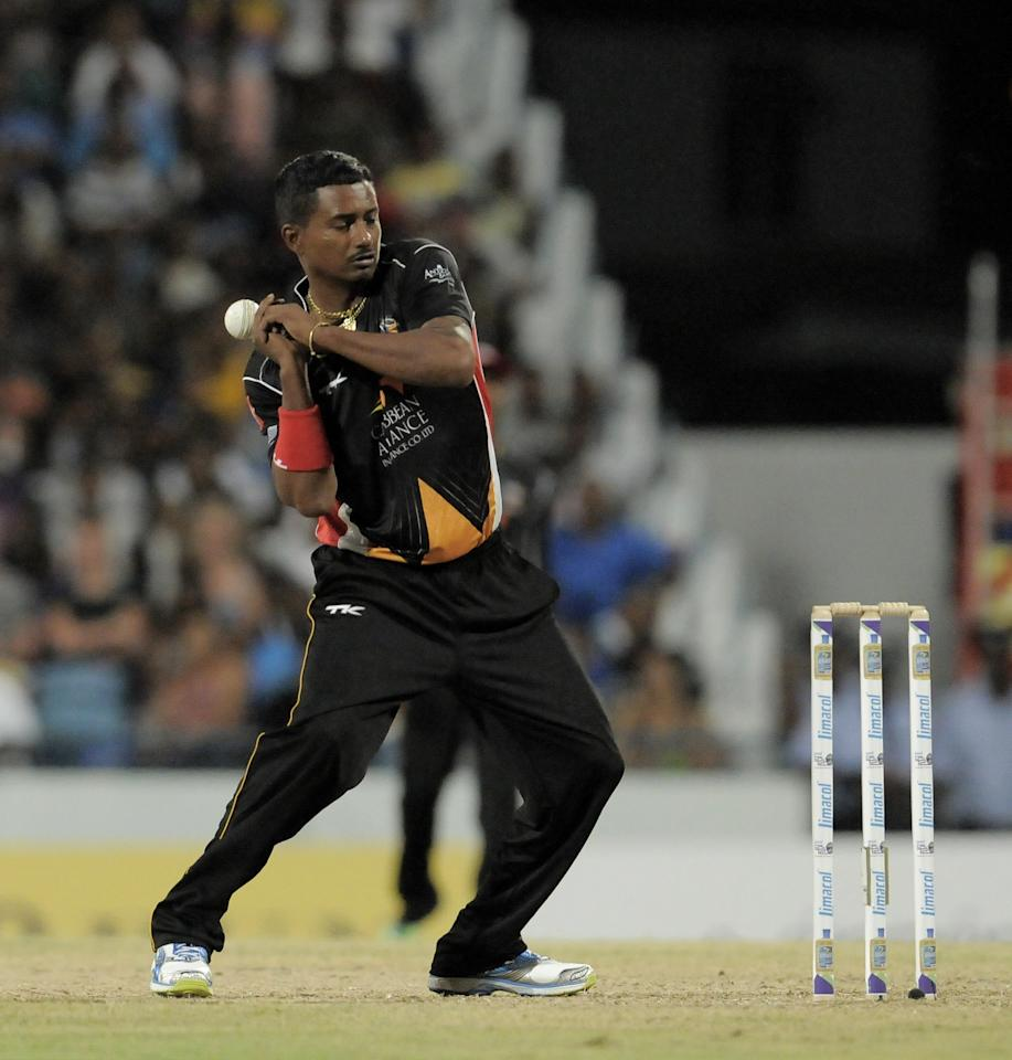 BRIDGETOWN, BARBADOS - AUGUST 01: Dave Mohammed of Antigua Hawksbills stopping the ball as it returns during the Third Match of the Caribbean Premier League between Antigua Hawksbills v Barbados Tridents at Kensington Oval on August 1, 2013 in Bridgetown, Barbados. (Photo by Randy Brooks/LatinContent/Getty Images Latin America for CPL)