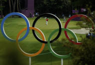 Austria's Sepp Straka, center, makes a putt on the 16th hole during the first round of the men's golf event at the 2020 Summer Olympics on Wednesday, July 28, 2021, at the Kasumigaseki Country Club in Kawagoe, Japan. (AP Photo/Matt York)