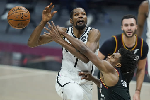 Cleveland Cavaliers' Collin Sexton, right, knocks the ball loose from Brooklyn Nets' Kevin Durant during the second half of an NBA basketball game, Wednesday, Jan. 20, 2021, in Cleveland. (AP Photo/Tony Dejak)