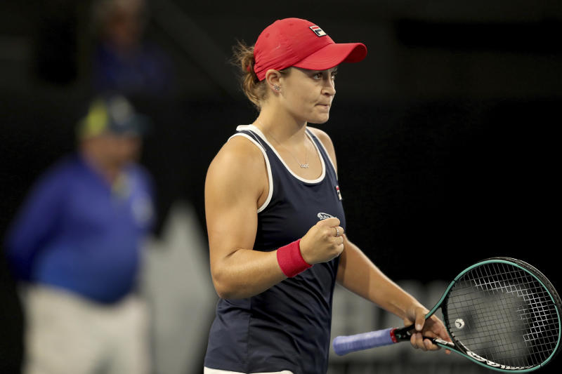 Ashleigh Barty of Australia celebrates winning against Danielle Collins of the United States during their Adelaide International tennis match in Adelaide, Friday, Jan. 17, 2020. (AP Photo/James Elsby)