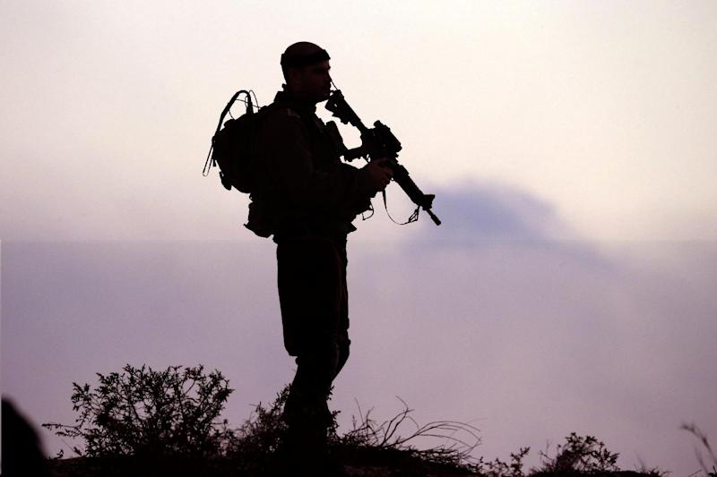 An Israeli soldier keeps his position near the border with the Gaza Strip, on July 29, 2014