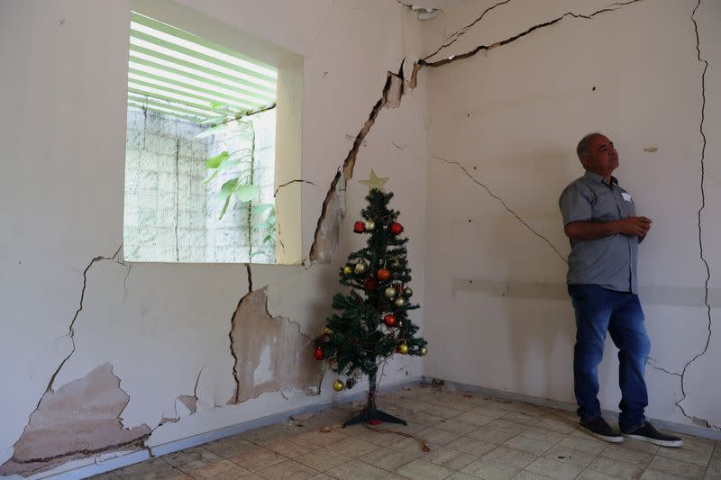 Jose Rinaldo Januario is pictured in his house next to cracks linked to rock salt mining by the petrochemical company Braskem in Maceio