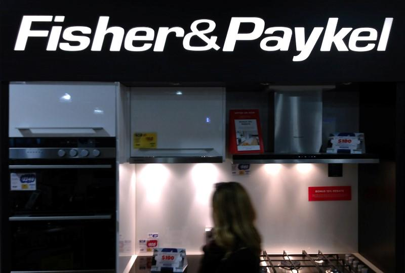 A customer walks past a display for Fisher & Paykel kitchen appliances at a department store in Sydney, Australia