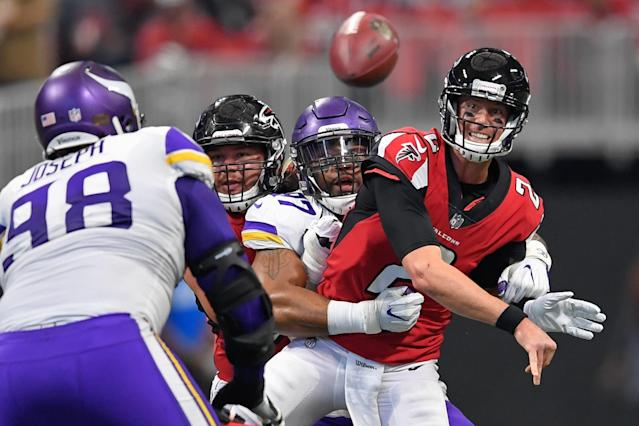 <p>Atlanta Falcons quarterback Matt Ryan (2) throws the ball as Minnesota Vikings defensive end Everson Griffen (97) defends during the first quarter at Mercedes-Benz Stadium. Mandatory Credit: Dale Zanine-USA TODAY Sports </p>
