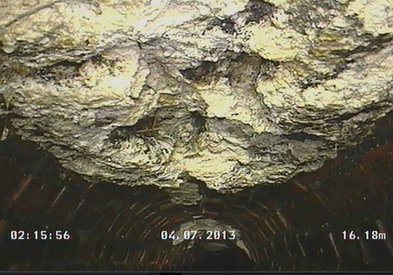 Picture released by CountyClean Environmental Services shows the congealed 'fatberg' in a sewer in Kingston, London
