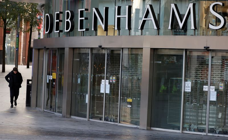 A person walks past a Debenhams store, in Liverpool