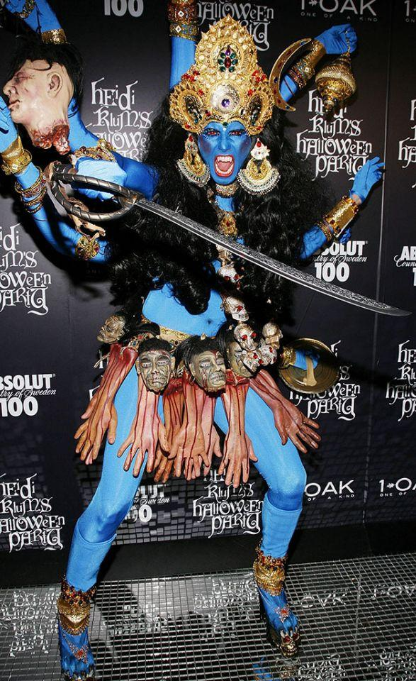 <p>No. 18: In 2008, Heidi went all out as Kali, the Hindu goddess of destruction. Created on a base of a blue bodysuit (and matching face paint), the look was all about accessories, which included heads, hands, red beady eyes, and a sword. While it was a memorable look, it wasn't a winner for everyone. Her portrayal of the deity with vampire fangs and a skirt made of severed bloody hands upset Hindu leaders. A costume that offends people gets a place at the bottom of the list. (Photo: Joe Kohen/WireImage) </p>