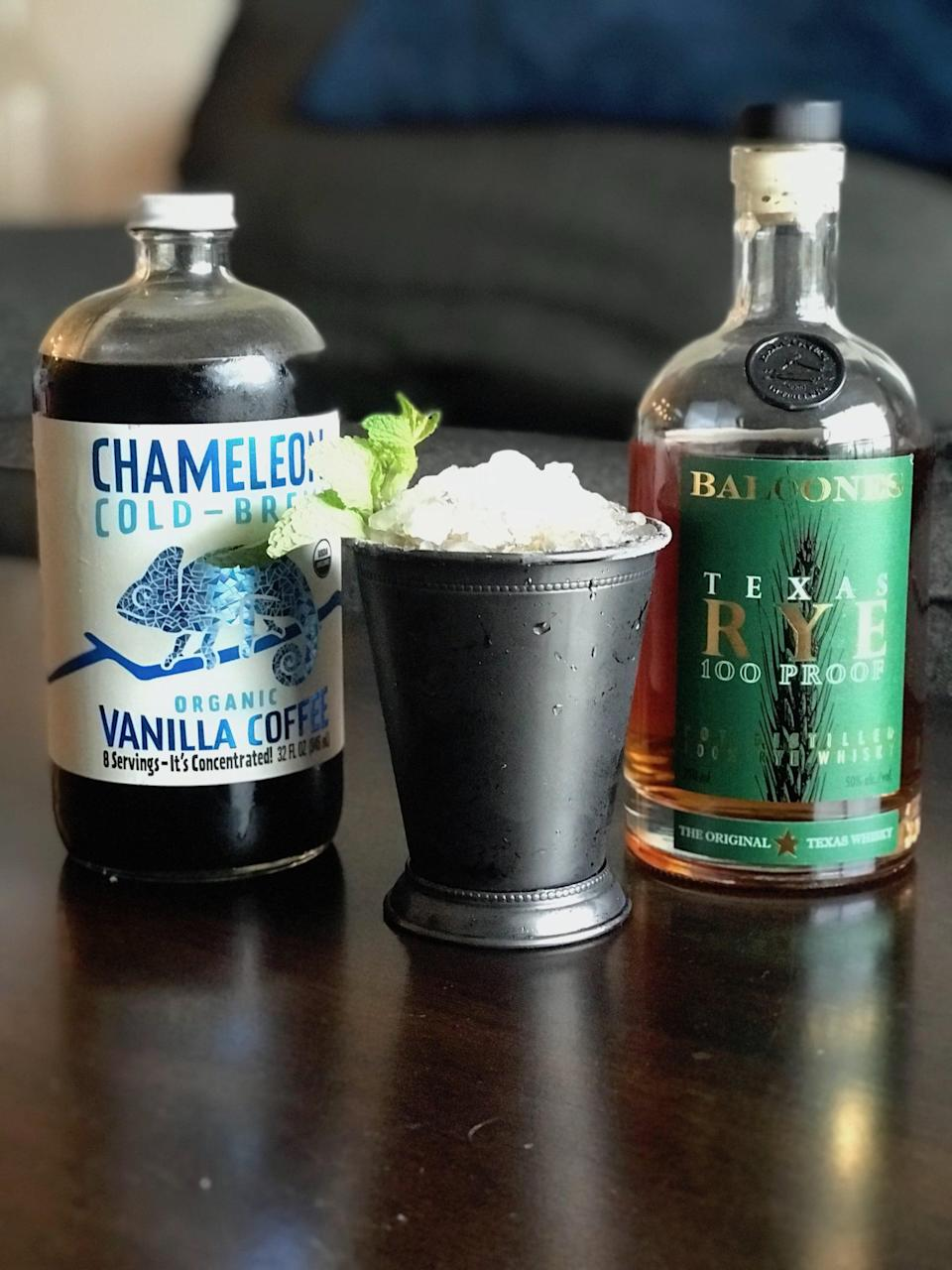 """<p>The next time you need a dose of energy and a cooldown, fix yourself this cold brew mint julep, created by Toné Castillo for <a href=""""http://www.chameleoncoldbrew.com/recipe/cold-brew-mint-julep-recipe/"""" class=""""link rapid-noclick-resp"""" rel=""""nofollow noopener"""" target=""""_blank"""" data-ylk=""""slk:Chameleon"""">Chameleon</a>. </p> <p>Ingredients: </p> <ul> <li>2 oz. Balcones Rye </li> <li>1 oz. Chameleon Cold-Brew Vanilla Coffee Concentrate </li> <li>10 mint leaves </li> <li>3/4 oz. simple syrup </li> </ul> <p><strong>Directions: </strong>Muddle 10 mint leaves with simple syrup in a shaker, then add rye and the Chameleon cold brew. Shake well, then pour over an ice-filled glass and garnish with a sprig of mint. </p>"""