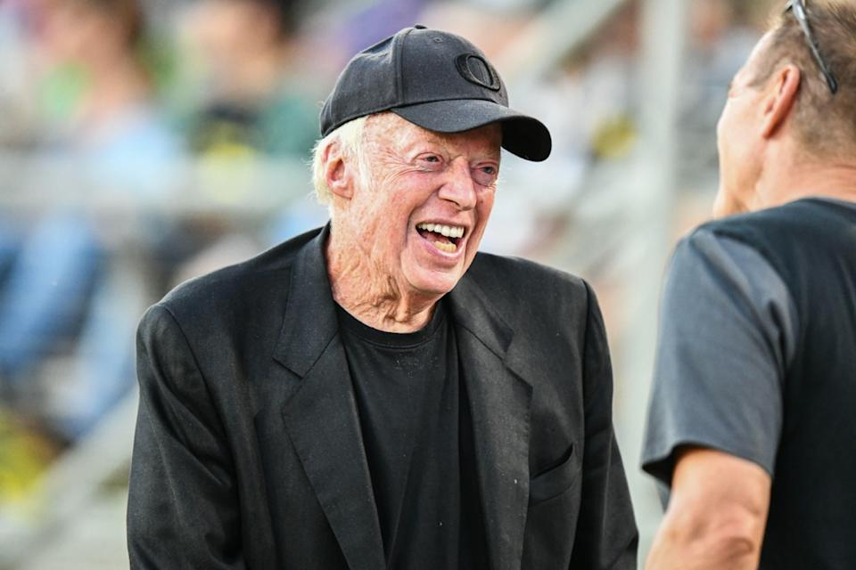 Nike co-founder Phil Knight is all smiles on the sideline during the NCAA football game between the Oregon Ducks and the Stanford Cardinal at Stanford Stadium