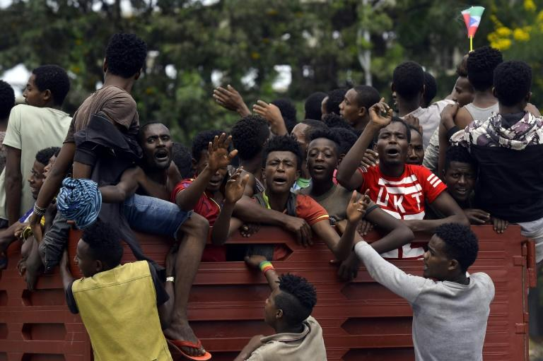 Youngsters ride in the back of a truck during celebrations over plans to declare a breakaway region of Sidama (AFP Photo/Michael TEWELDE)