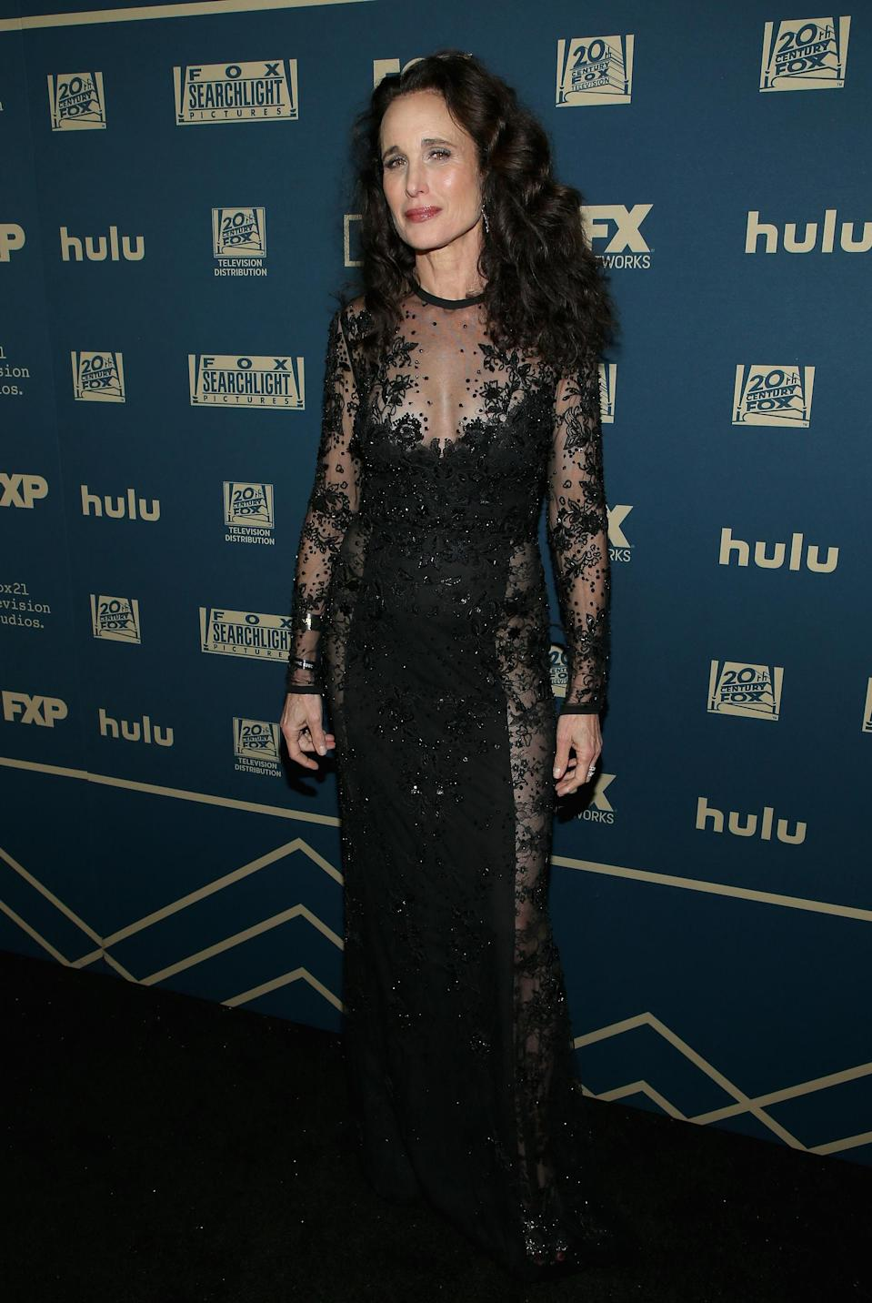 <p>Wearing a sheer lace dress. <em>[Photo: Getty]</em> </p>