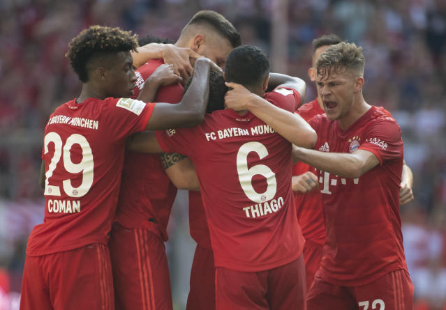 Munich's players celebrate their side's equalizing goal during a German Bundesliga soccer match between Bayern Munich and FSV Mainz 05 in Munich, Germany, Saturday, Aug.31, 2019. (Sven Hoppe/dpa via AP)